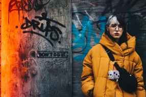 Canva - Woman in Yellow Coat With Black Crossbody Bag Closing Her Eyes